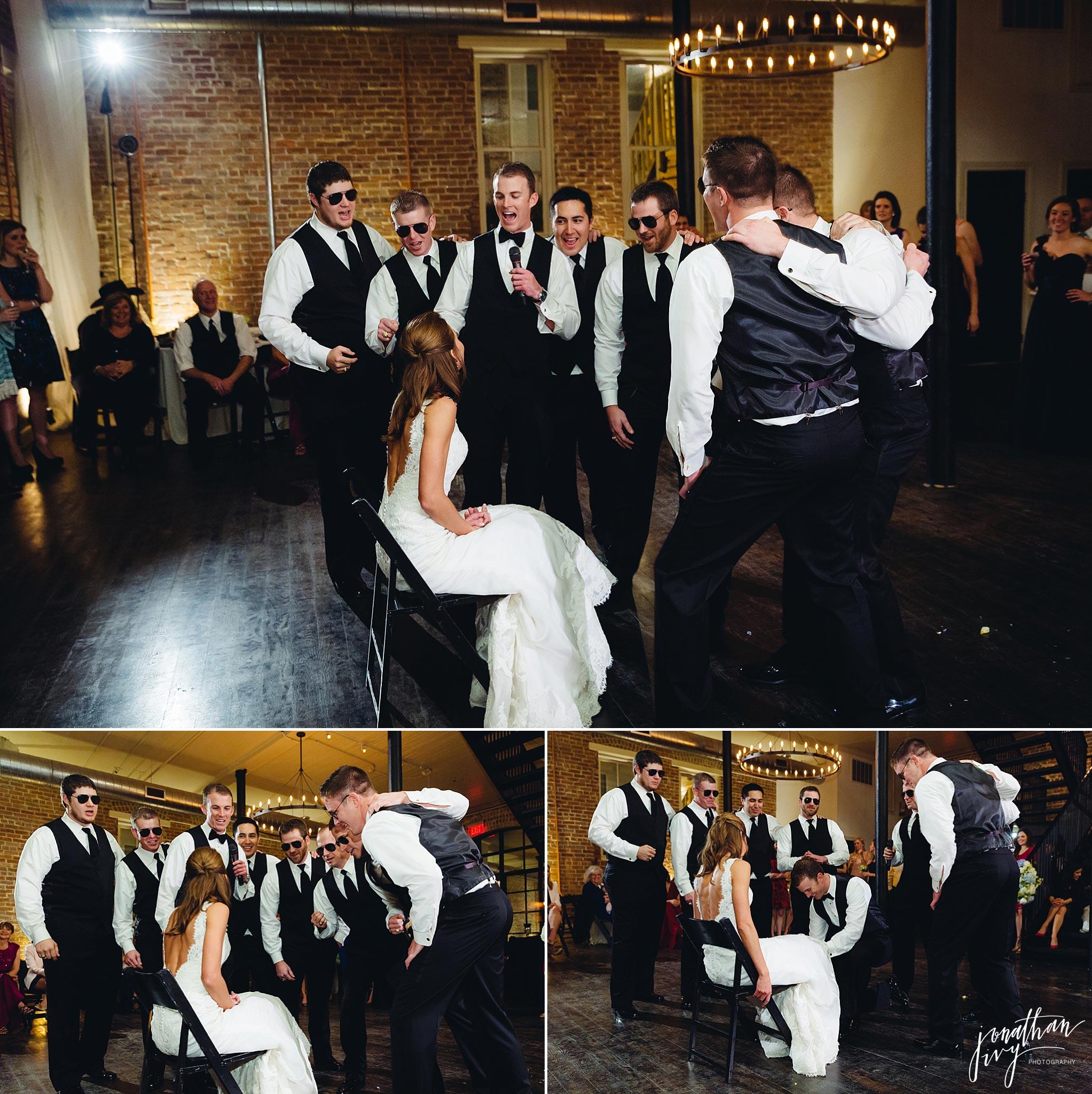 Groomsmen singing to bride at reception