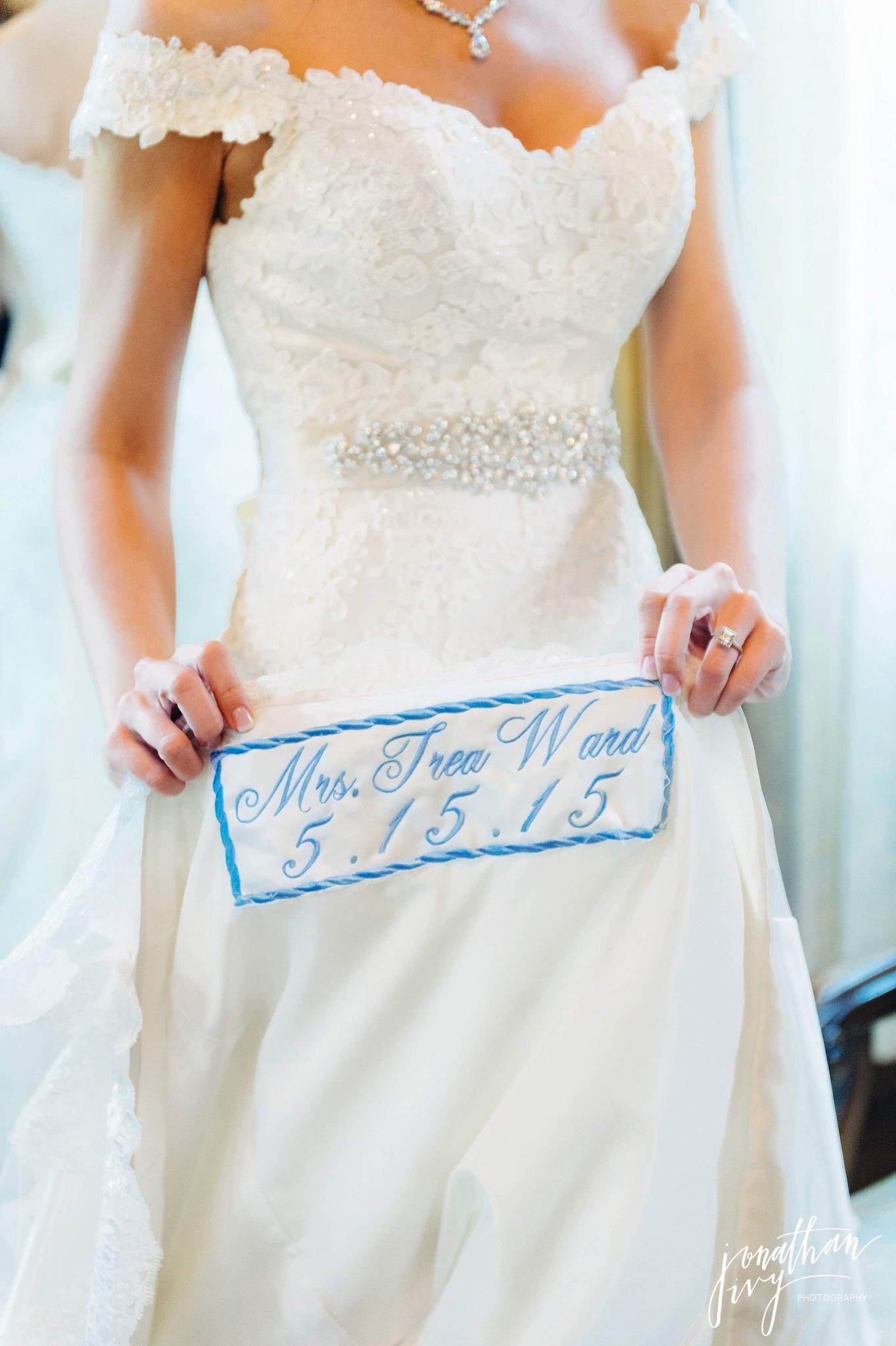 something blue embroidered wedding date on dress hem line