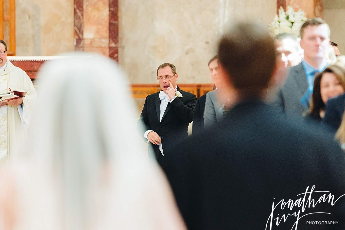 groom seeing bride walking down aisle