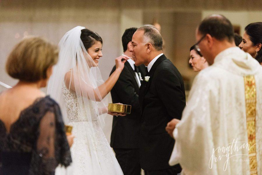 Bride giving father communion