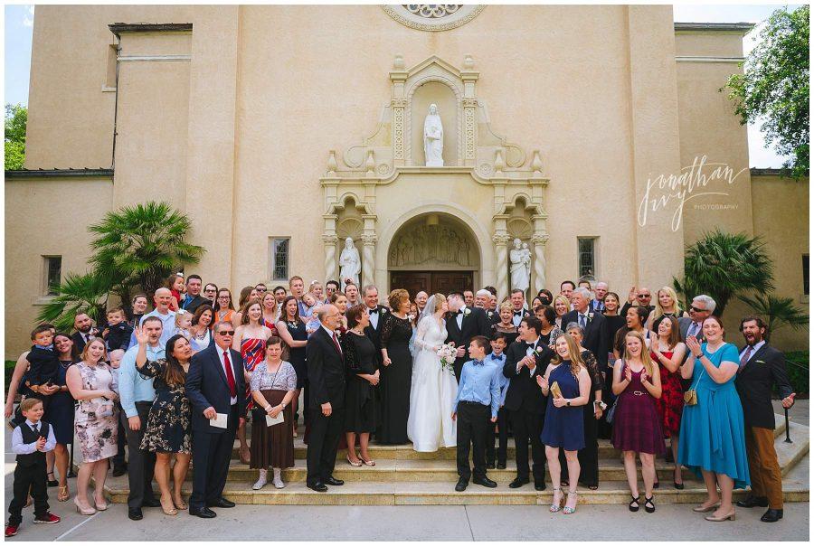 family surrounding newlywed couple