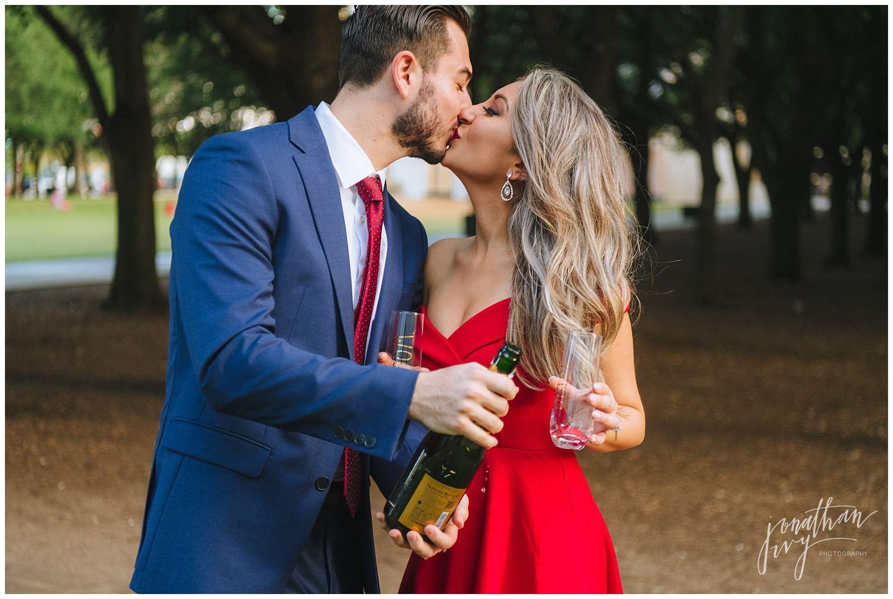 Engagement photos with champagne