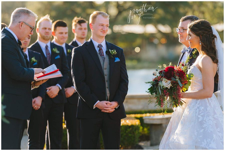 emotional groom while bride walks down aisle